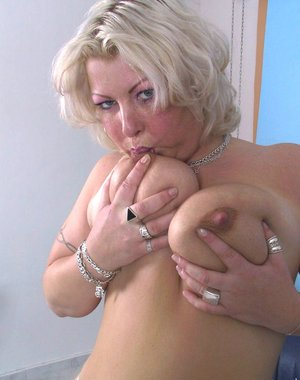 Big titted mature nympho playing and sucking cock