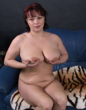 Big titted mature slut sucking and playing with herself