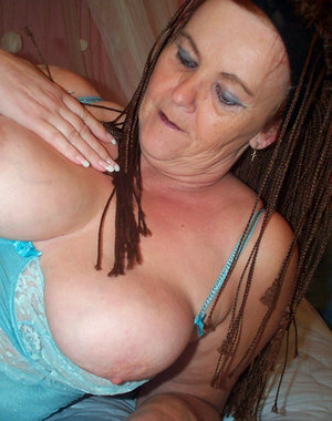 Big titted granny playing with herself