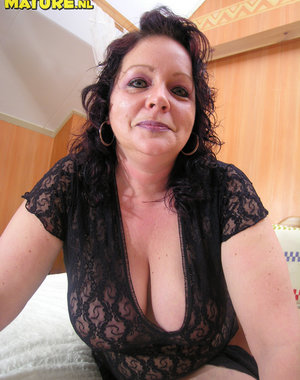 Big titted housewife loving a big dildo