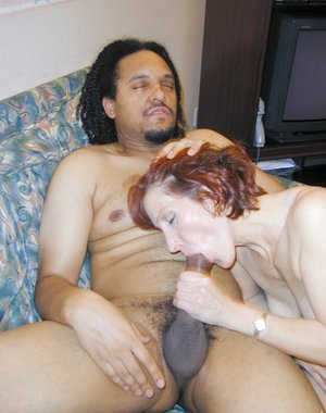 Horny housewife sucking and fucking a black mans cock
