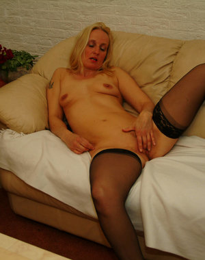 Blonde mature nympho playing with herself
