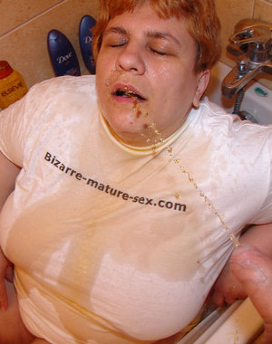Chunky mature slut fisted and pissed on