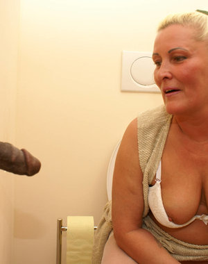 This granny loves to suck and fuck through the gloryhole