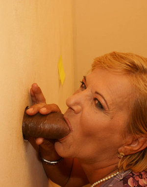 Horny mature slut just loves our gloryhole