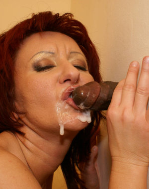 This kinky mature slut gets a black cock through the gloryhole