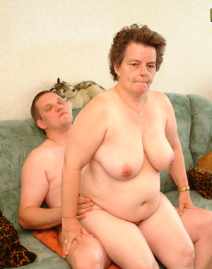 Chunky granny fucking and sucking a dude on her couch