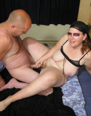 Mature couple fucking hard on their bed