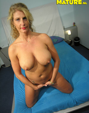 Blonde mature nympho enjoying her toys