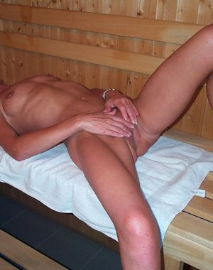 Horny housewife getting hot in the sauna