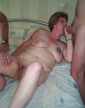 Mature swingers having a big party on the bed