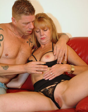 Horny mature couple fucking on the couch