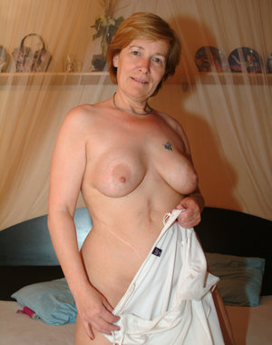 This horny older babe loves to show her stuff