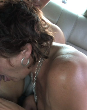 Horny slut sucking two guys in a car