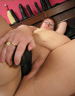 See her taste a rubber dildo and play with herself