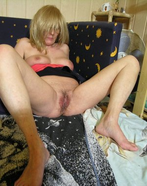 Horny mature slut showing us her wet cunt