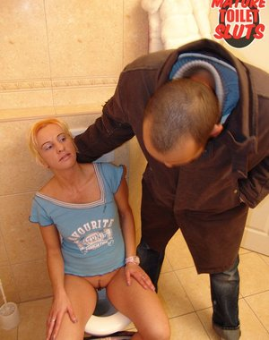 Horny blonde mature getting kinky on a toilet