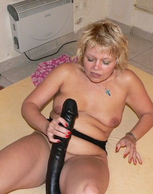 See her fucking that huge black dildo