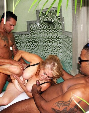 mature slut getting banged by two black cocks