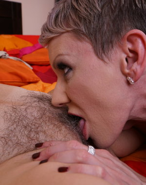 Hot mom having fun with a hairy mature lesbian