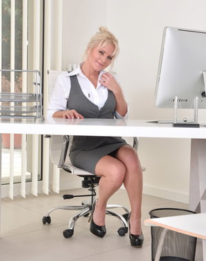 Hot blonde MILF getting wet at the office