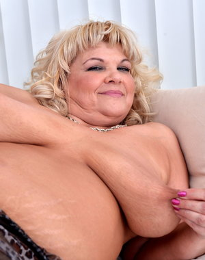 Blonde big breasted mature BBW playing with herself