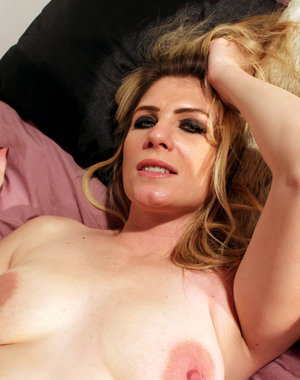 Horny British MILF playing with her toys