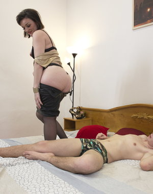 Naughty housewife playing with a younger boy