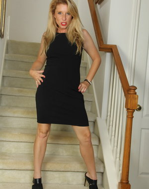 Naughty American MILF playing on the stairs