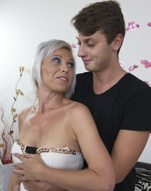Naughty housewife getting her younger lover in the mood