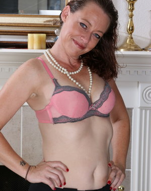 Naughty American housewife getting frisky