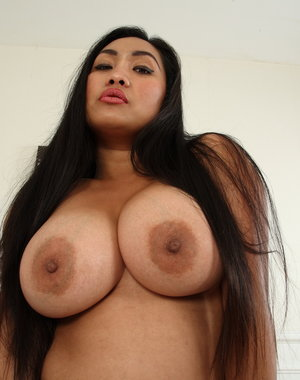 Hot Asian big breasted housewife playing with herself