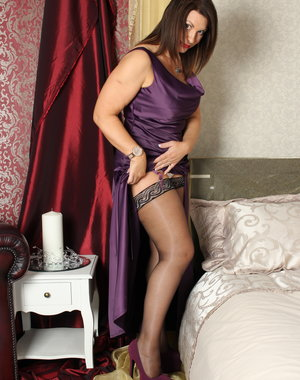 Naughty British MILF playing in bed