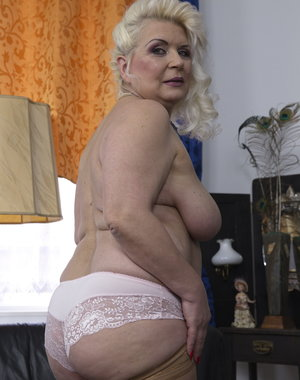 Chubby mature lady playing all by herself