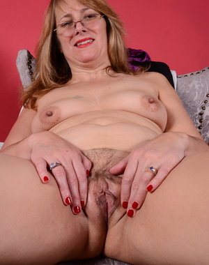 This American housewife plays with her unshaved pussy