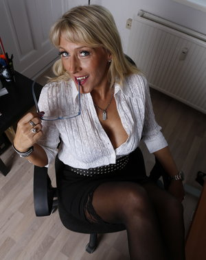 Hot German housewife taking it all off