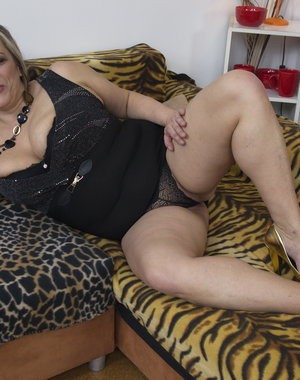Big breasted mature lady playing with herself