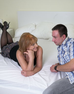 This hairy mature lady loves to play with her toyboy