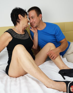 Naughty mature lady fooling around with her toy boy