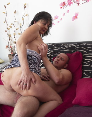 Horny mature lady doing her younger lover