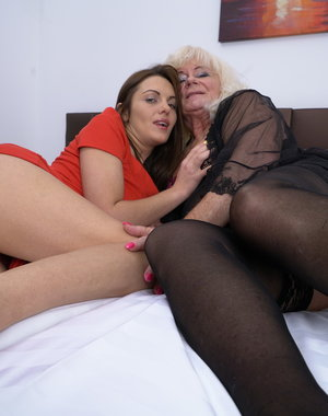 Old and young lesbian couple making out