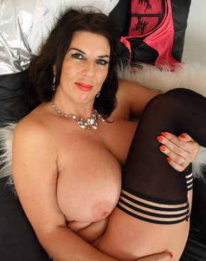 Big breasted British housewife playing alone