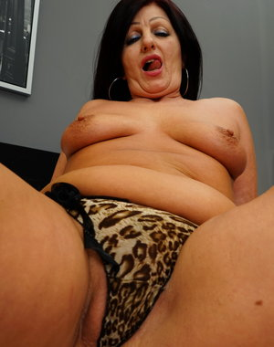 Naughty mature lady playing alone