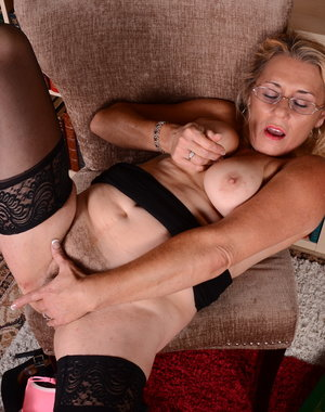 Hairy American housewife playing alone