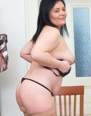 Chubby mature lady stripping and teasing