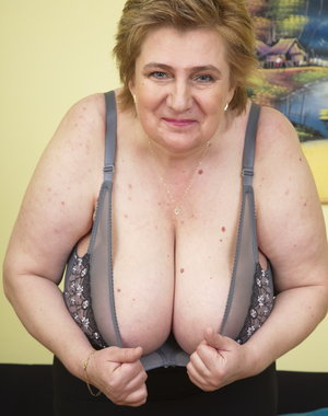 Hairy huge breasted mature lady playing all alone