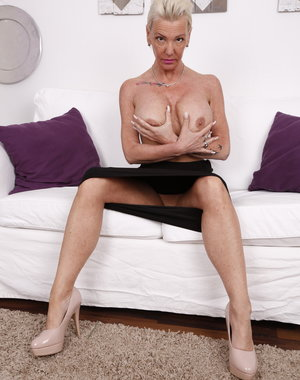 Naughty German housewife playing on the couch