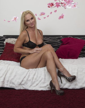 Hot blonde MILF teasing and getting ready to become naughty