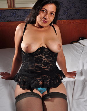 Hairy Latin mature lady playing with herself