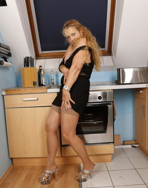 Horny German housewife gets naughty